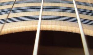 Как разобраться при покупке гитары из чего она сделана