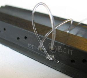 Як правильно зав'язати/закріпити струни: 12 отворів на підставці